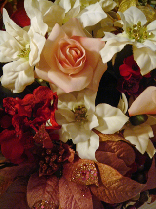 Closeup of bouquet over fireplace